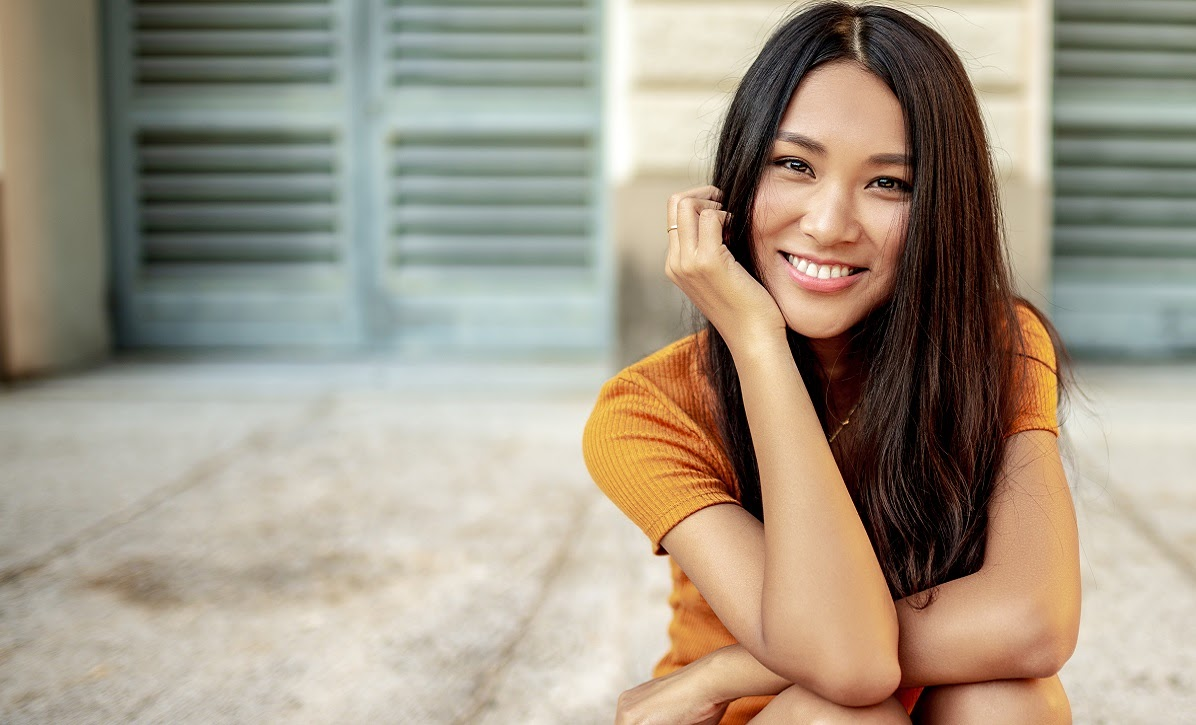 Portrait of a beautiful smiling Chinese woman looking at the camera