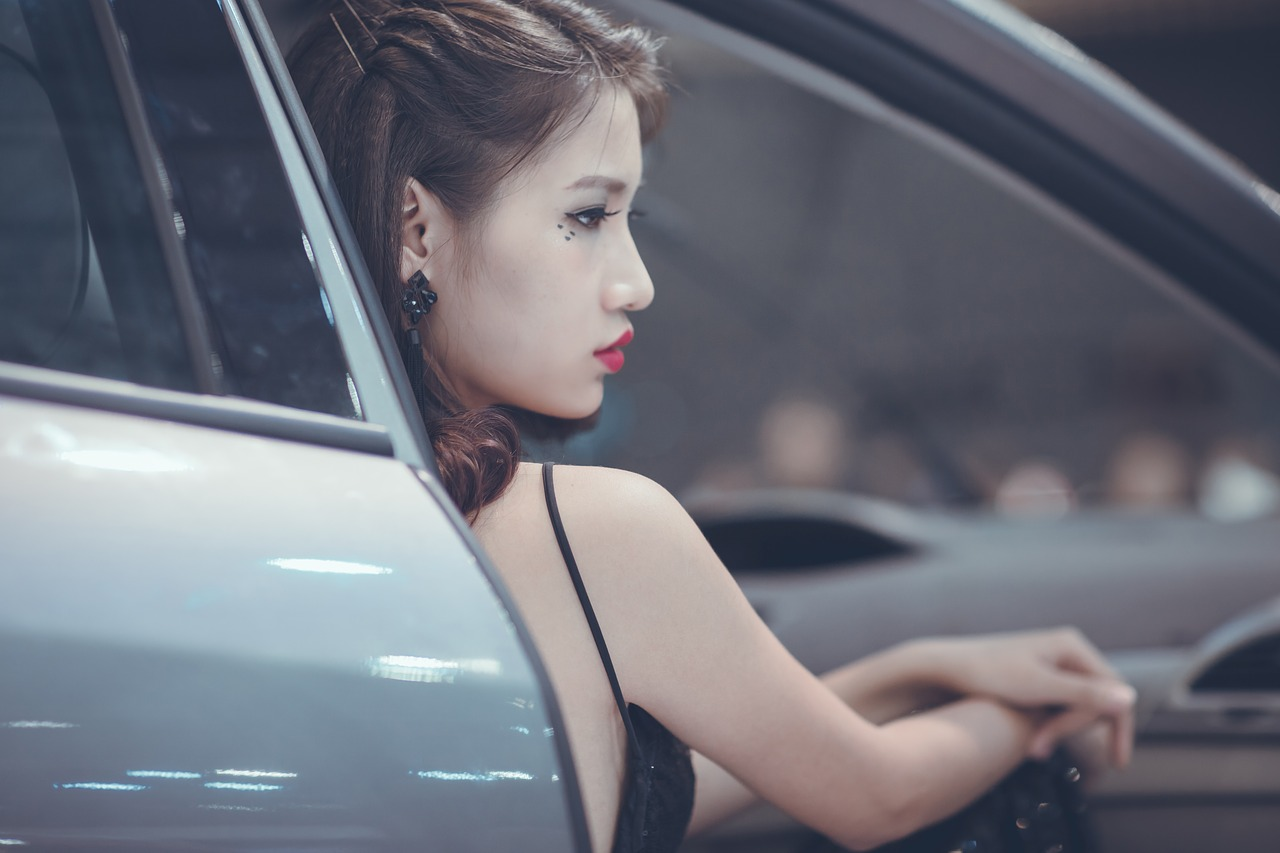 portrait of Chinese woman in car