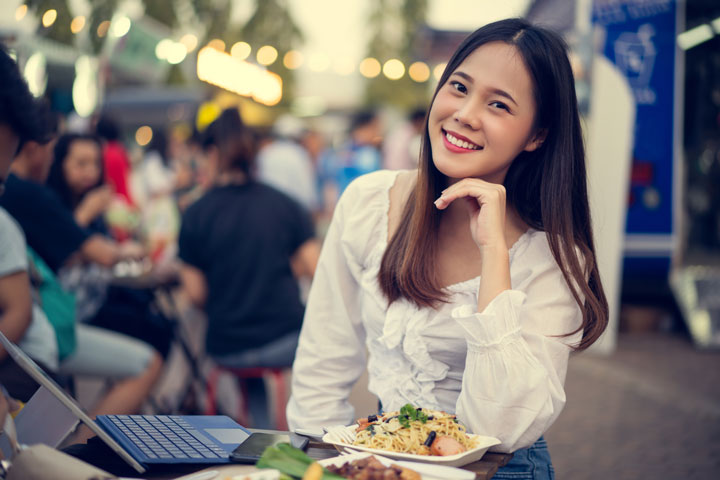 asian woman eating street