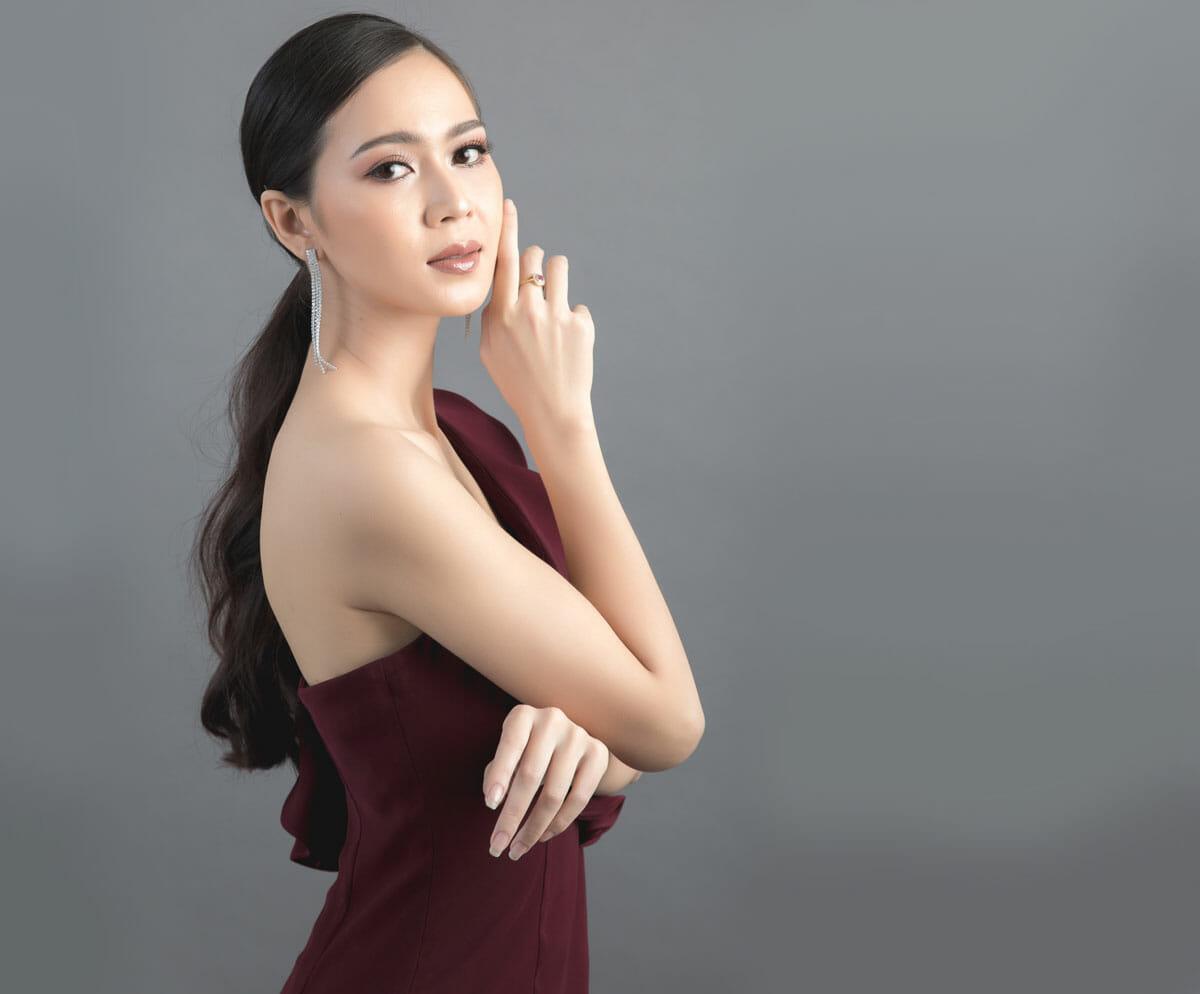 beautiful Filipino woman face hand make up